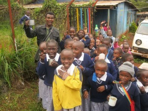 Njenga visiting Compassion sponsored children in Kenya