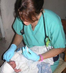 Shelly assisting a baby in the mountains of Haiti, 2006