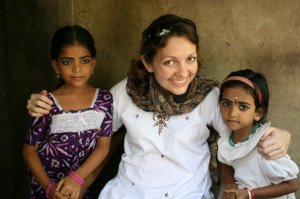 Amber, in one of her trips, sharing with two little Indian girls